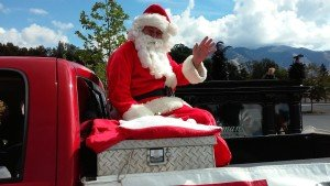 Santa riding in a parade