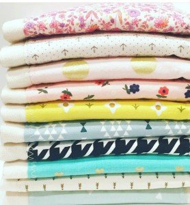 stack of baby burp cloths
