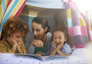 Mother reading to kids
