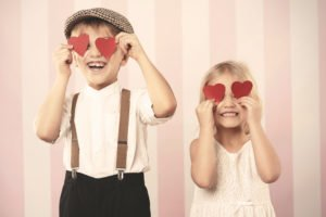 Two kids with hearts on the eyes
