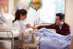 Family With New Born Baby In Post Natal Hospital Department