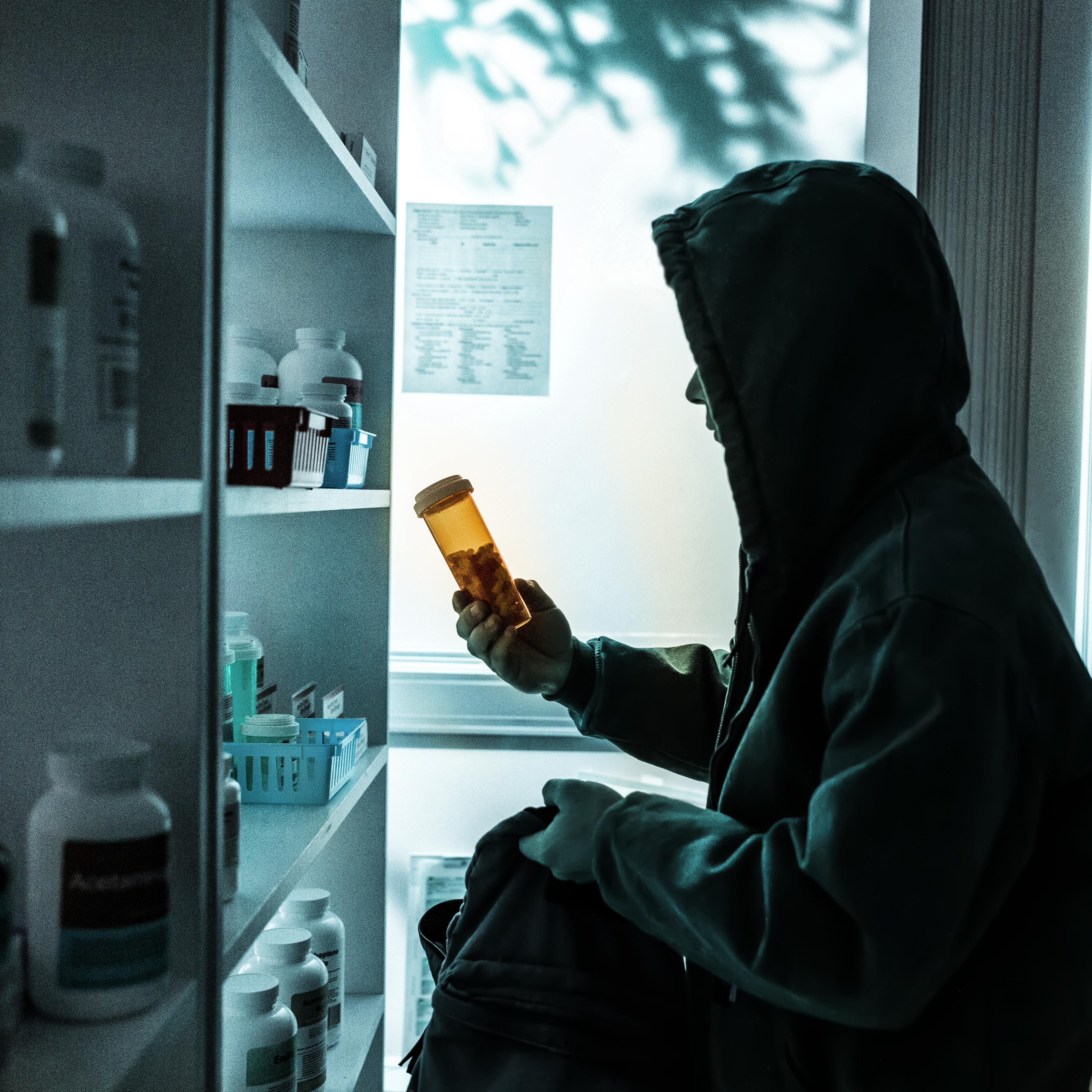 the dangers of prescription drug abuse cache valley family magazine a young male drug addict stealing prescriptions off the shelf of a pharmacy