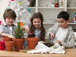 Children potting plants