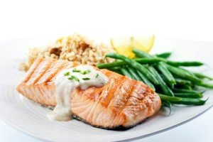 Salmon served with rice and vegetables