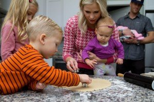Mom making cookies with children
