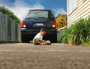 Child playing in a driveway