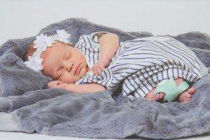 Baby sleeping with Owlet Smart Sock