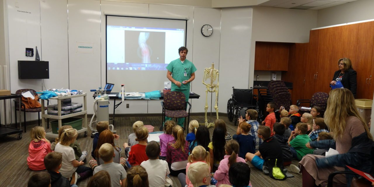 Local Volunteers Teach Second Graders about 'Our Friend the Hospital'